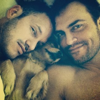 cheyenne jackson family - boyfriend and dog in bed