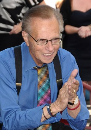 larry king wearing his bright colored suspenders