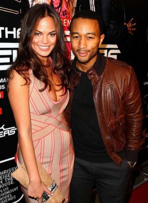 celebrities wearing gucci leather jackets john legend