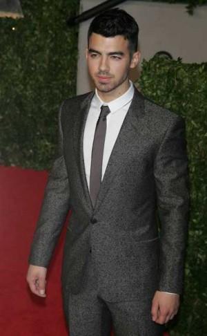 celebrities wearing calvin klein ck suits - joe jonas