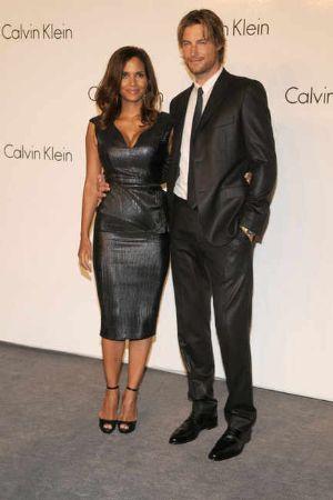 celebrities wearing calvin black klein dresses halle berry ck resort