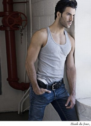 latino male model wearing jeans and tank top shirt