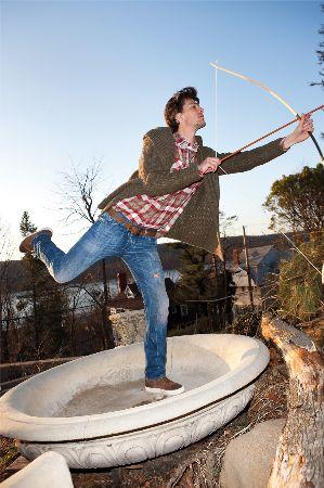 male model archery wearing diesel jeans