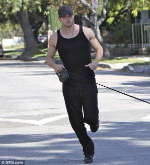 kellan lutz running in hollywood. black jogging suit and black tank top shirt
