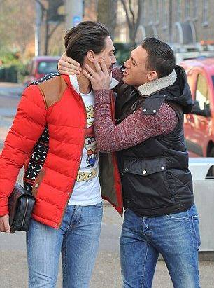 Kirk Norcross gives Mario Falcone a kiss on the lips