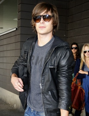 celebrities wearing superdy leather hoodie
