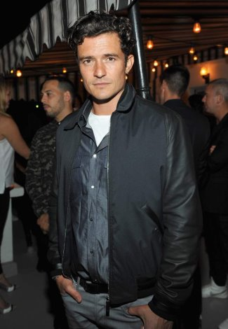 celebrities wearing dior homme leather jackets - Orlando Bloom in DH black nylon jacket with leather sleeves