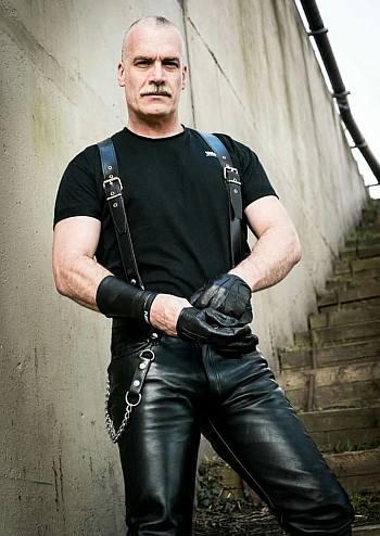 older male model wearing leather pants - sam waterston