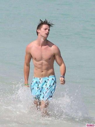 patrick schwarzenneger body at the beach