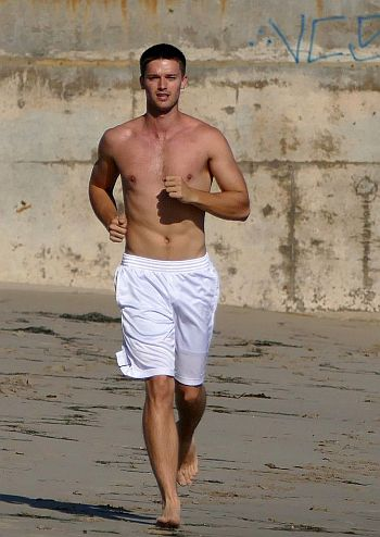 patrick schwarzenegger shirtless at the beach