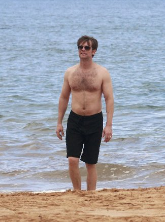 peter krause no shirt in beach shorts