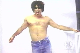 garth brooks no shirt wearing jeans