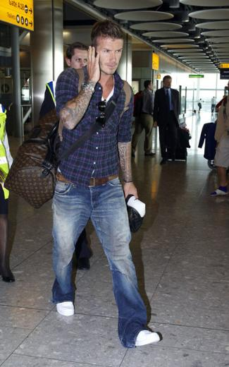 male celebrity with louis vuitton keepall bag - david beckham