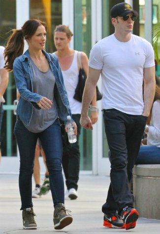 chris evans in body fitting under armour shirt with minka kelly