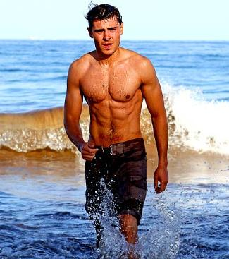young men with six pack - zac efron