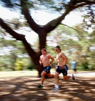 Michael Hooper left and Berrick Barnes shirtless run during a Waratahs Super Rugby training session at Centenial Park sydney