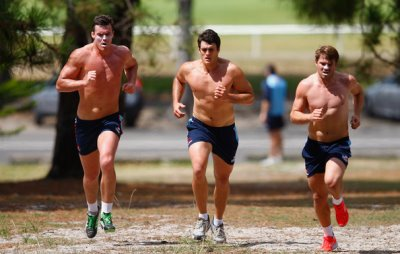 shirtless waratahs rugby hunks - left to right - Kane Douglas and Dave Dennis and Drew Mitchell run uphill during a Waratahs Super Rugby training session at Centenial Park