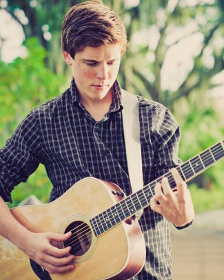 sam woolf country hunk with guitar