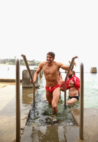 Josh Kennedy in speedo - Swans swims during a recovery session at Coogee Beach