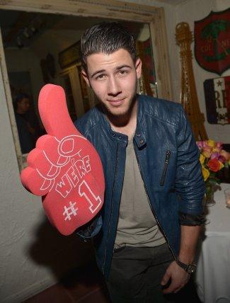celebrities wearing belstaff leather jackets - Nick Jonas in Belstaff Kirkham biker jacket