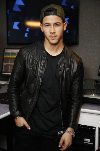 Nick-Jonas-Wears-Maison-Martin-Margiela-Leather-Moto-Jacket-and-Helmut-Lang-Tee