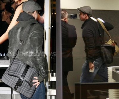 mens designer bags - Brad Pitt with a Burberry Check Messenger Bag-1