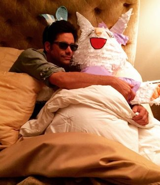 hot guys in their 50s - john stamos bed with bunny