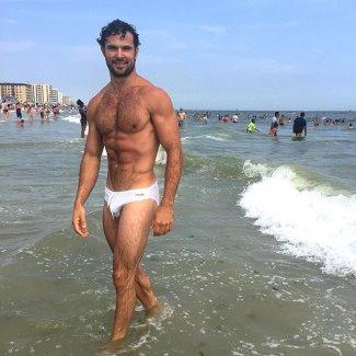 male model wearing white speedo - walter savage