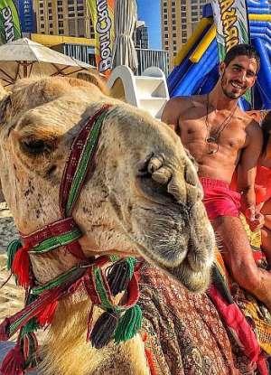 ahmed-shihab-eldin-shirtless-camel-ride