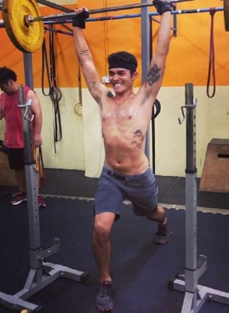 henry golding shirtless working out