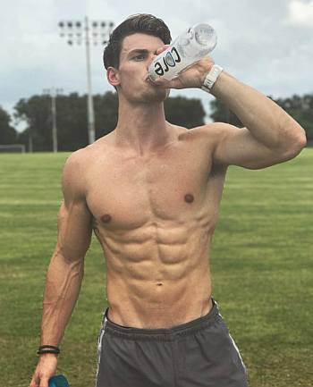 hot guys with abs garrett miller drinking