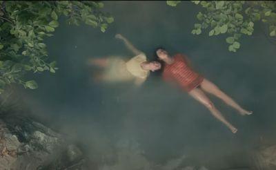 ellie aster bathing in the pond scene2