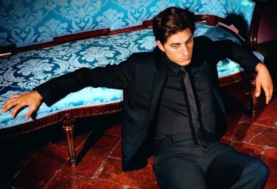 Luca Marinelli models dolce and gabbana suit and tie