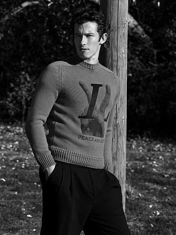 men in sweaters callum turner - louis vuitton and alexander mcqueen pants