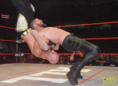stephen amell wrestling in leather pants