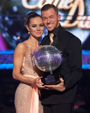 Artem Chigvintsev winners trophy - strictly with kara tointon