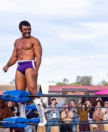 Joseph Lee Anderson shirtless in wrestling trunks