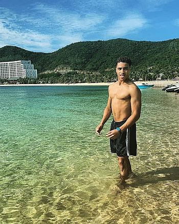Theo Graham shirtless beach body