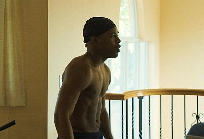 Kelvin Harrison Jr shirtless body in waves