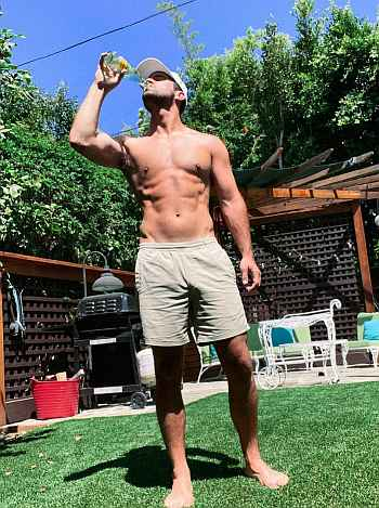 Nick Uhlenhuth shirtless with abs